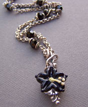 Pua Aloalo - Black Hawaiian Necklace Hibiscus
